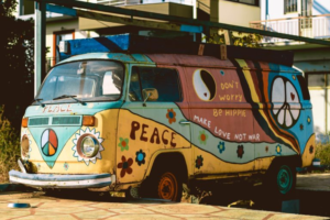 A vintage Volkswagen Van painted with Peace signs and flowers