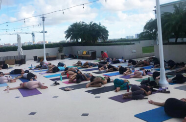 people doing yoga on the roof of Hotel Arya in Coconut Grove