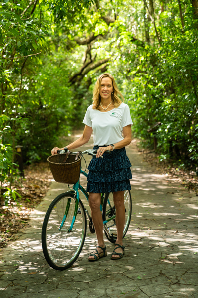 woman standing bicycle tropical hammock forest